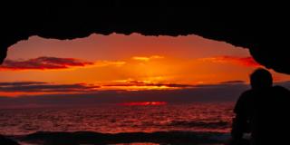 Man watching a beautiful sunset