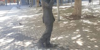 Statue of a man walking and talking on the phone in Cape Town