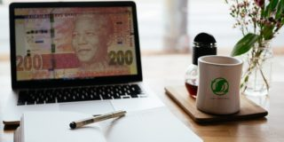 Computer and note book representing making money online in South Africa